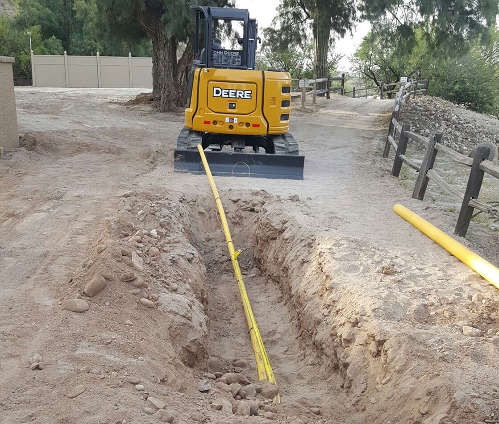 photo of Liberty Gandy Pipeline gas services in action; A large trench with new pipeline being lain down