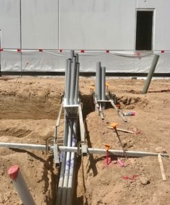 photo of a large construction project and the power conduits