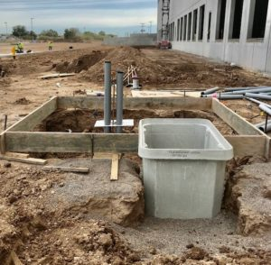 photo of a construction project; electrical conduits and forms prepared for a concrete pour
