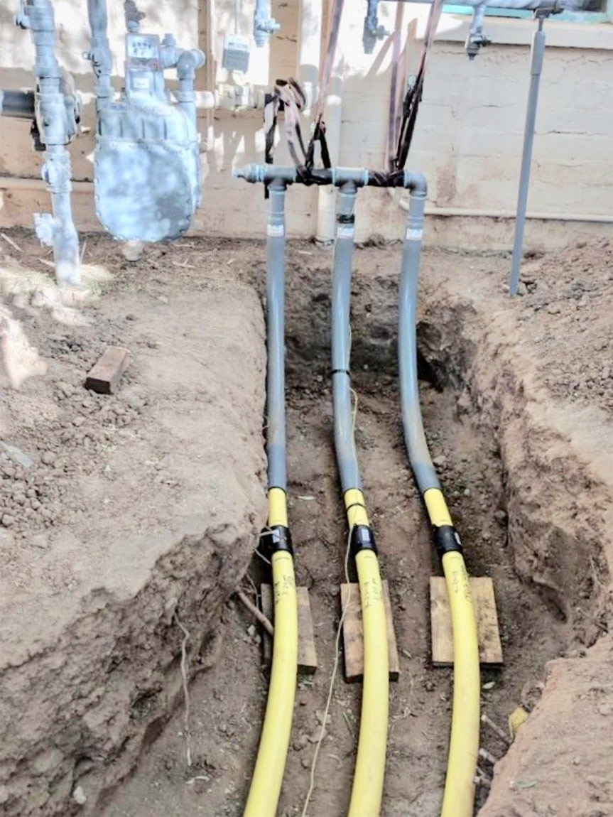 Photo of Liberty-Gandy project, three gas pipes going into a home underground, showing how they are masters of natural gas line repair near me